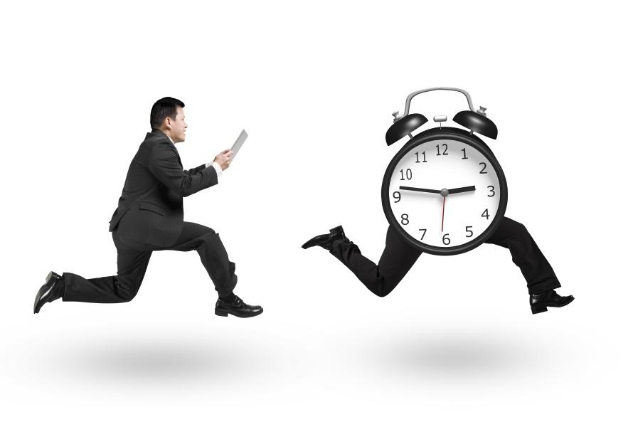 Man using tablet running after alarm clock of running legs