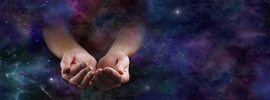 Our Abundant Universe - Male hands emerging from a wide dark dee