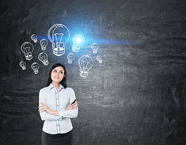 Girl with black hair near blackboard with blue light bulbs