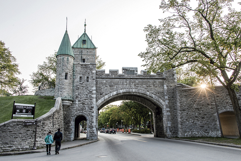 Quebec City Canada historic fortified wall with street sunset with couple going for a stroll