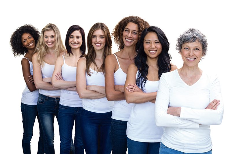Happy multiethnic women standing in a line with hands crossed