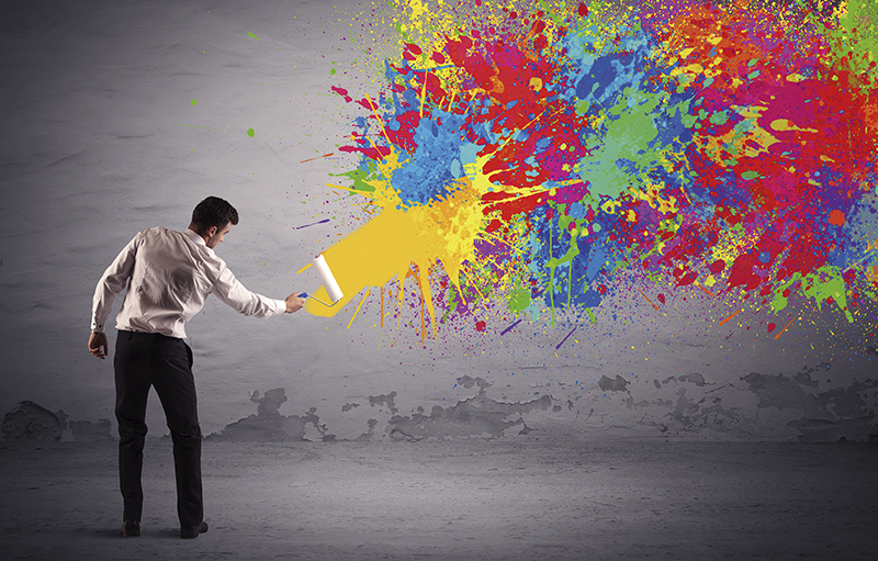 Sales person painting colorful splatter